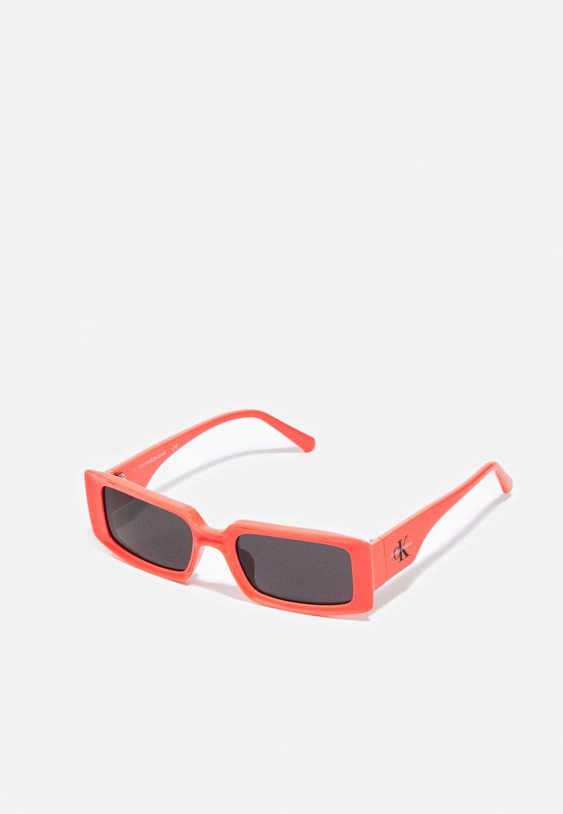 Calvin Klein Jeans - UNISEX - Sunglasses - coral