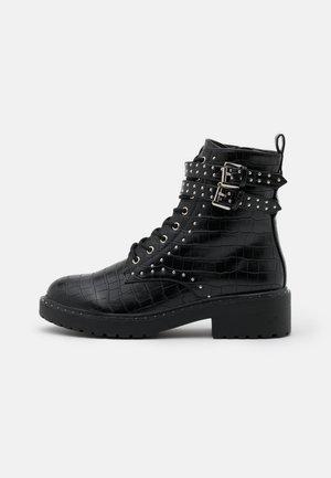 MAJESTIC STUD LACE UP BOOT - Cowboy/biker ankle boot - black