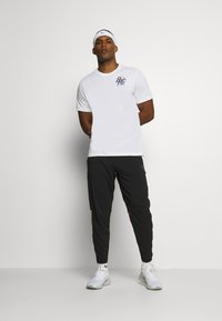 Nike Performance - DRY TEE - Print T-shirt - white - 1