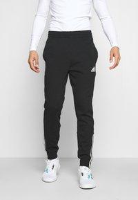 adidas Performance - DK ESSENTIALS - Tracksuit bottoms - black/white - 0