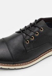 Call it Spring - VEGAN TORBEN - Zapatos con cordones - black - 5