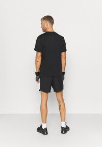Nike Performance - DRY PACK - T-shirt con stampa - black - 2