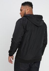 Urban Classics - CONTRAST WINDRUNNER - Summer jacket - black/white - 2