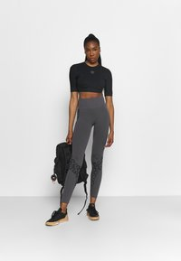 adidas by Stella McCartney - CROP - T-shirt basic - black - 1