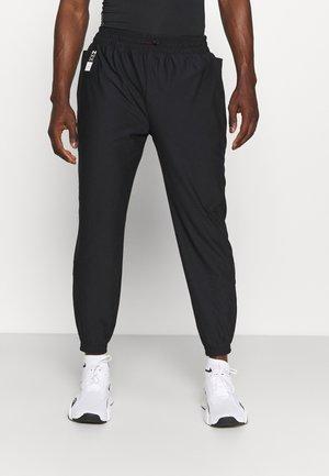 RUN ANYWHERE PANT - Pantalones deportivos - black