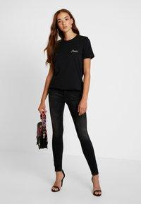Vero Moda - VMPUKKA - T-shirt basique - black - 1