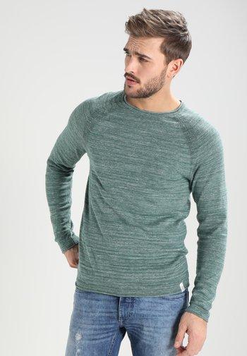 Stickad tröja - mottled green