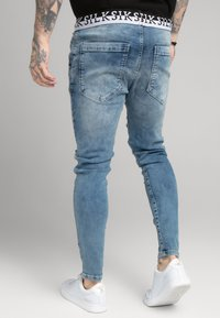 SIKSILK - DISTRESSED ELASTICATED - Jeans Skinny Fit - washed raw blue - 4