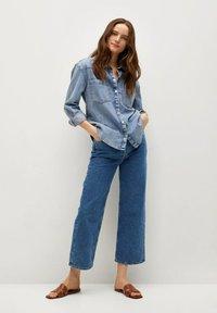 Mango - GABRIELA - Flared Jeans - donkerblauw - 1