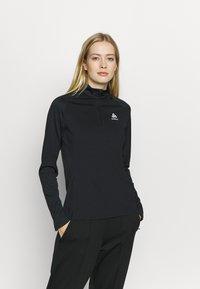 ODLO - MIDLAYER CERAMIWARM ELEMENT - Camiseta de deporte - black - 0
