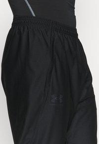 Under Armour - TRACK PANT - Teplákové kalhoty - black - 5