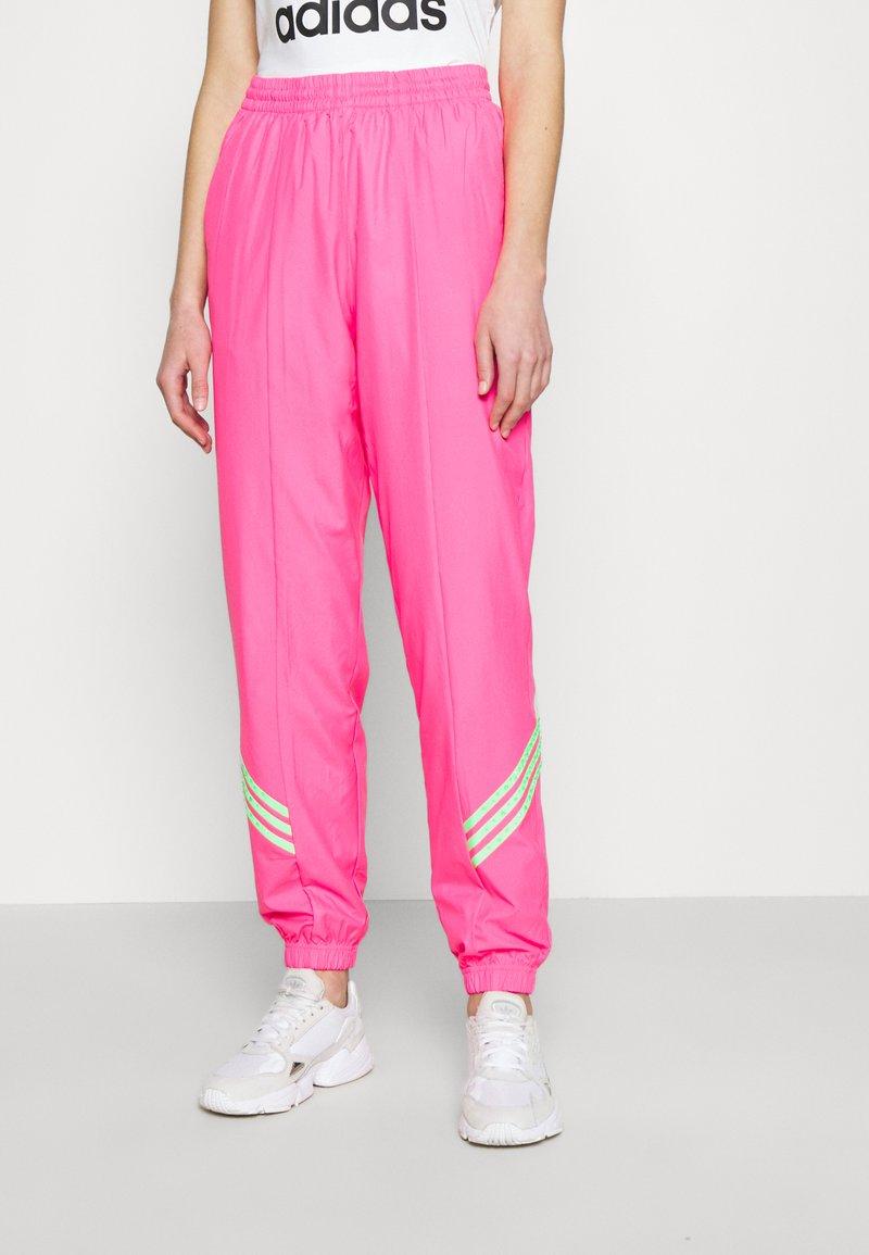 adidas Originals - SWAROVSKI TRACK PANT - Träningsbyxor - solar pink