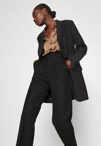 Hope - KEEN TROUSERS - Spodnie materiałowe - black - 3
