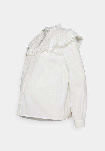PCMEVANGLA SHIRT - Button-down blouse - bright white