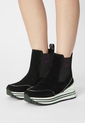 MAXI - Platform ankle boots - black