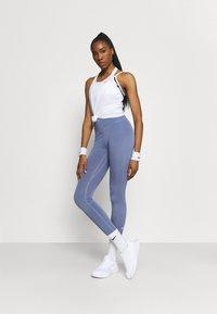 Nike Performance - DRY ELASTIKA TANK - Funktionströja - white/black - 1