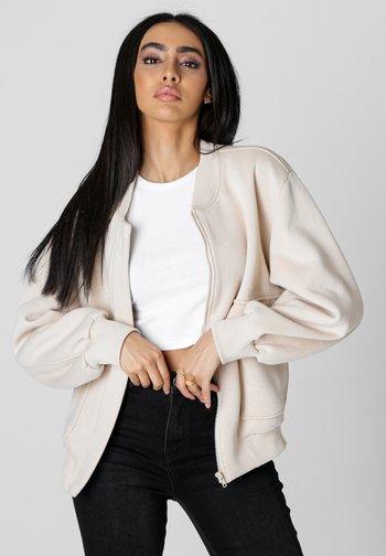 COLLEGE RICARDA - Zip-up sweatshirt - beige