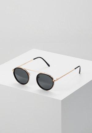 Sunglasses - pale gold-coloured black/smoke