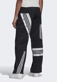 adidas Originals - DANIËLLE CATHARI JOGGERS - Pantalon de survêtement - black - 1
