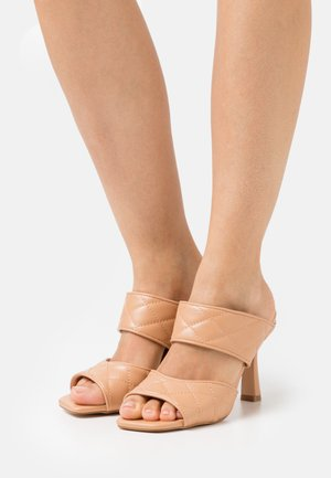 Heeled mules - soft nude