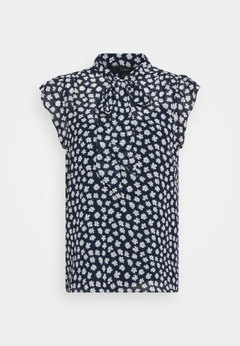 TIE NECK BLOUSE IN SCATTERED DAISIES
