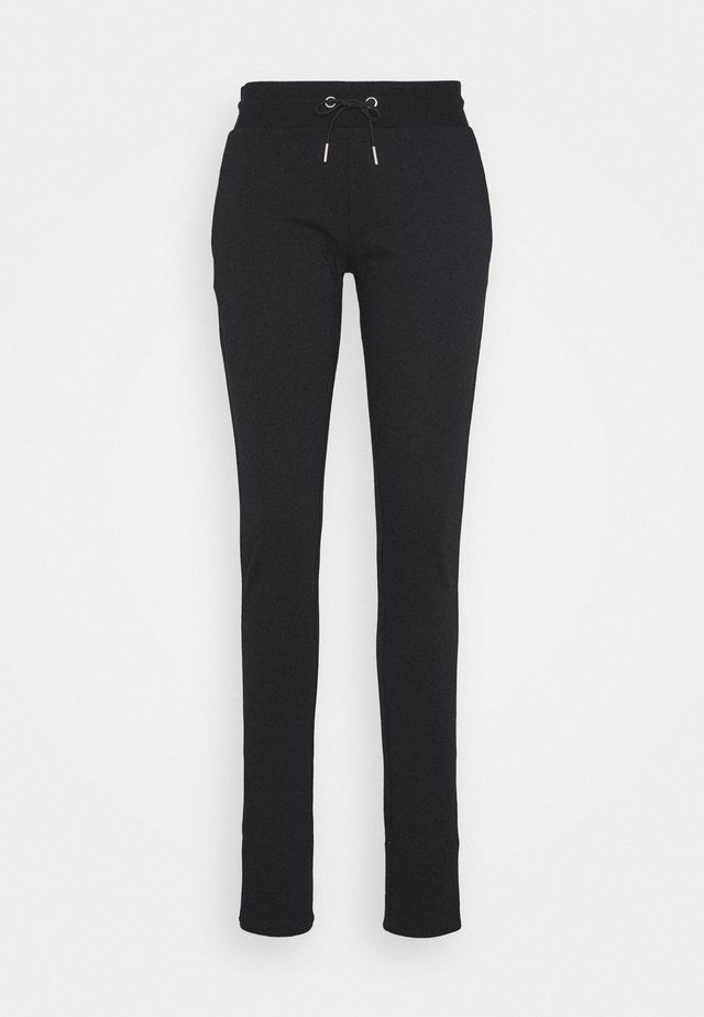 KARLA - Tracksuit bottoms - black