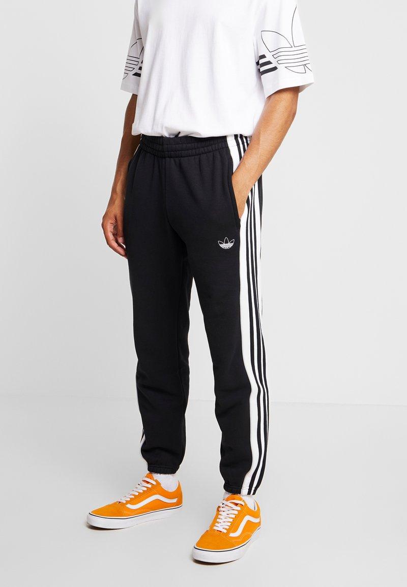 adidas Originals - STRIPE PANEL - Tracksuit bottoms - black/white