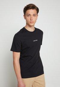 Calvin Klein - SUMMER GRAPHIC  - T-Shirt print - black - 2