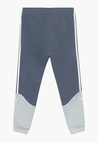 adidas Originals - Tracksuit bottoms - blue - 1