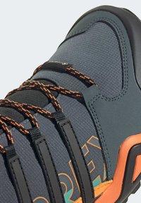 adidas Performance - TERREX SWIFT R2 MID GORE-TEX HIKING SHOES - Hiking shoes - green - 8