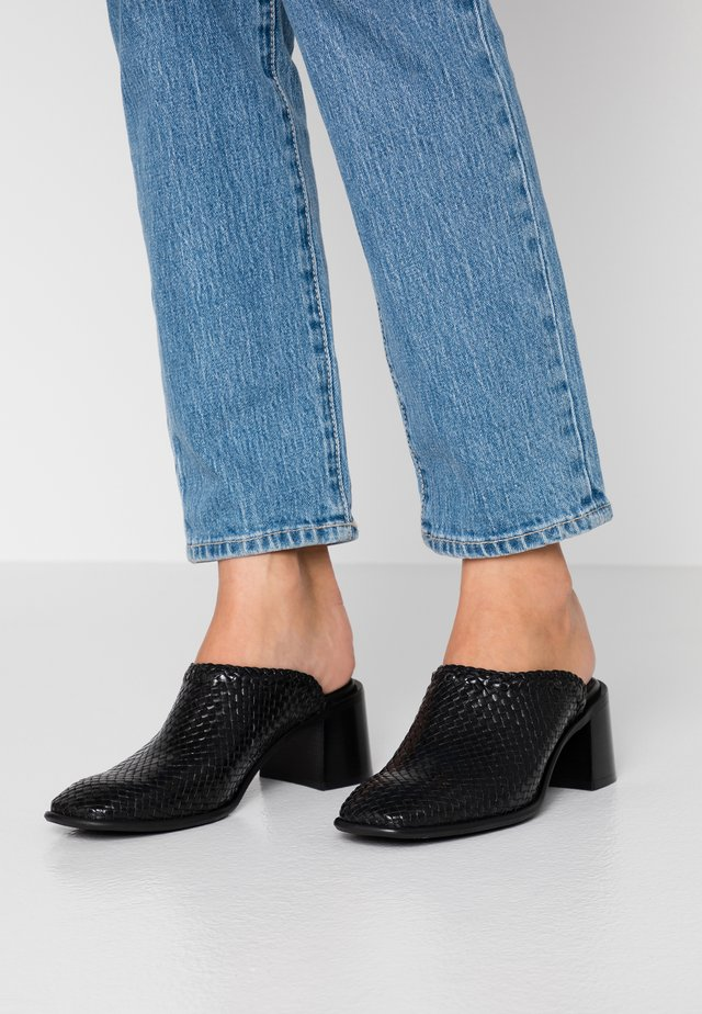 JINA - Heeled mules - black