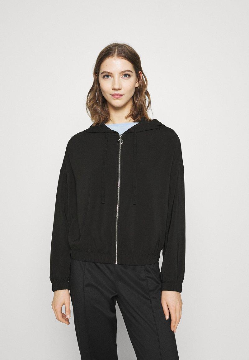 Vero Moda - VMCOCO HOODIE - Summer jacket - black