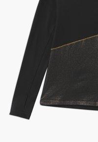 Nike Performance - Funkční triko - black/gold - 2