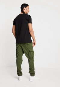 Alpha Industries - AIRMAN - Cargo trousers - dark oliv - 2