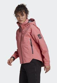 adidas Performance - Waterproof jacket - pink - 4