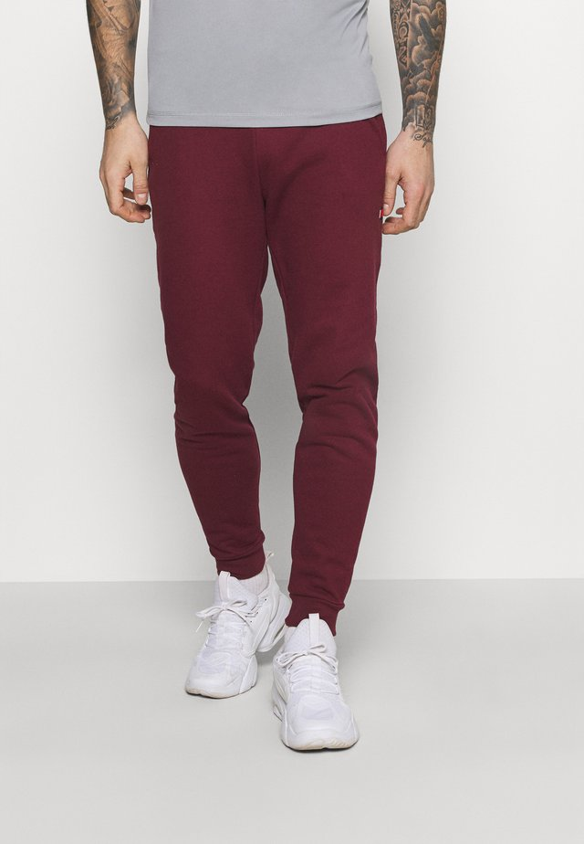 CUFF JOGGER - Trainingsbroek - purple