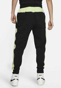 Nike Sportswear - AIR - Tracksuit bottoms - black/light liquid lime/white - 2