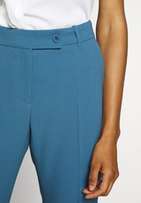 HUGO - HAMIRA - Trousers - dark blue - 6