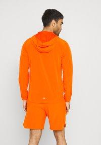 Calvin Klein Performance - PRIDE WINDJACKET - Trainingsvest - danger orange - 2