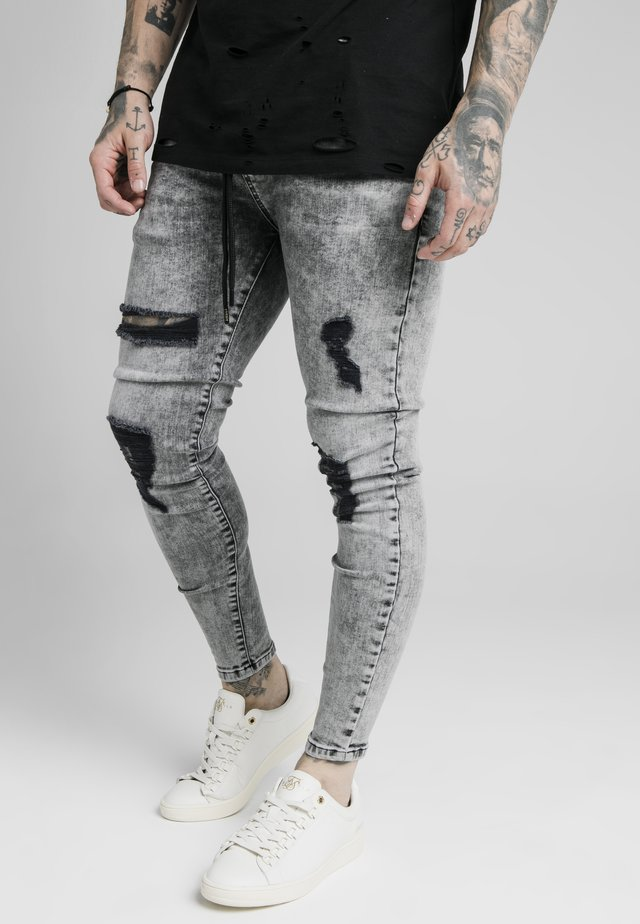 TAPE DISTRESSED - Jeans Skinny Fit - snow wash