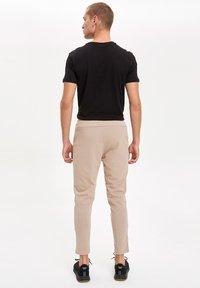 DeFacto Fit - Pantaloni sportivi - beige - 2