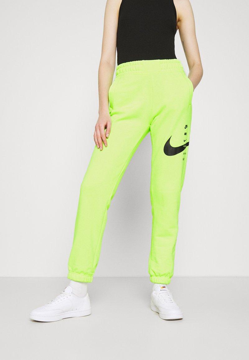 Nike Sportswear - PANT - Pantalon de survêtement - volt/black