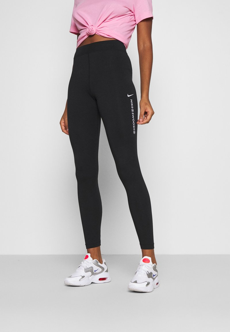 Nike Sportswear - Leggings - Trousers - black/white