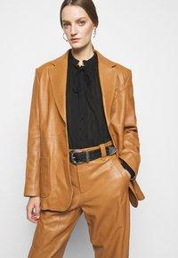 Alberta Ferretti - Leather trousers - brown - 6