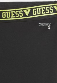 Guess - JUNIOR MICROFIBER - Leggings - Trousers - black/green combo - 2