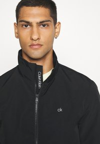 Calvin Klein - CASUAL BLOUSON JACKET - Summer jacket - black - 3