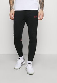 Nike Performance - ACADEMY 21 PANT - Tracksuit bottoms - black/siren red - 0