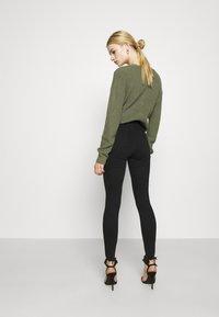 Topshop - JAGGED HEM JAMIE - Jeansy Skinny Fit - black - 2