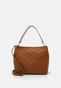 MCM - Handbag - cognac - 1