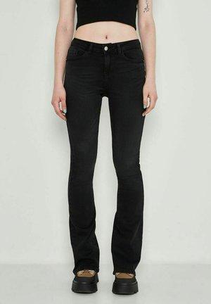 Jeans a zampa - black denim